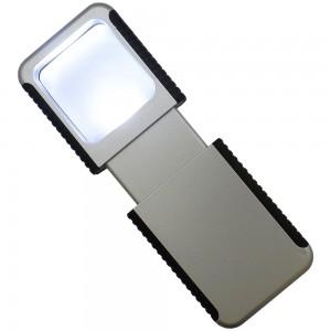Lupa de plástico com lanterna. Embalagem, caxinha branca